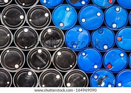 Blue & black oil barrels (Industrial background) - stock photo