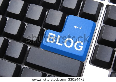 blue blog enter button on a computer keyboard - stock photo