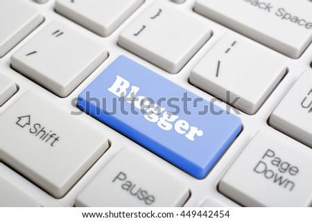 Blue blogger key on keyboard - stock photo