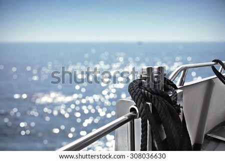 blue blurred background of sea with sunny sky and boat  - stock photo
