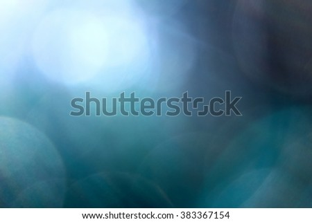 blue blurred background with flares