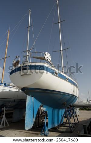 blue boat on dock - stock photo