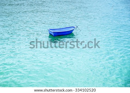 Blue boat on the sea  - stock photo