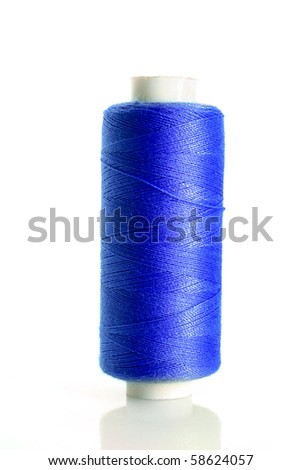 Blue bobbin thread isolated on white - stock photo