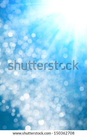 Blue Bokeh background with star backlit - stock photo