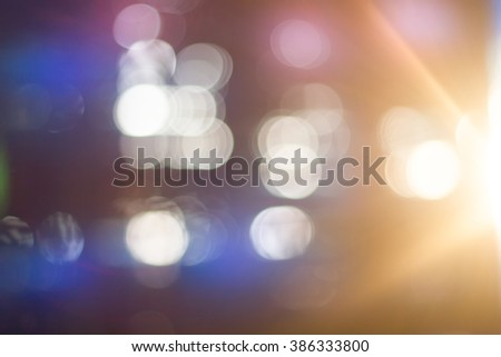 Blue bokeh. Blurred light on blue background. - stock photo