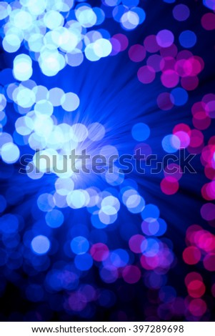 Blue Bokeh from defocused lights from a fiber optic lamp - stock photo