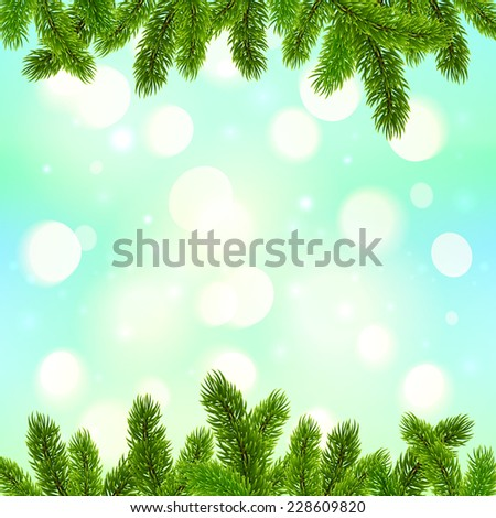 Blue bokeh light effect with fir tree branches frame Christmas background - stock photo