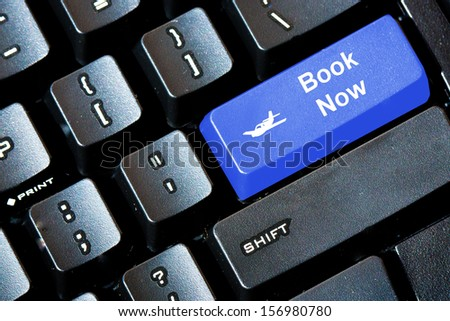Blue BOOK NOW button on a computer keyboard
