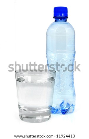 Blue bottle and glass of mineral water isolated on white - stock photo