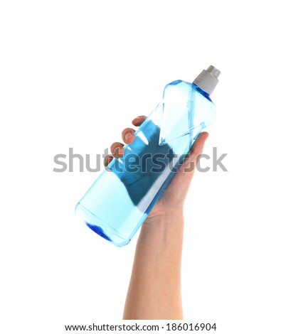 Blue bottle in a hand. Isolated on a white background.