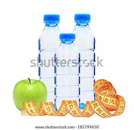 Blue bottles with water, measure tape and green apple isolated on white background - stock photo