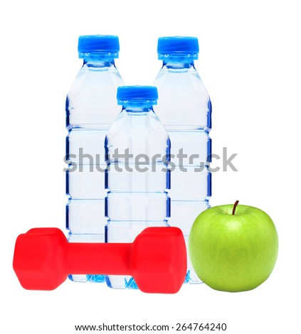 Blue bottles with water, red dumbell and green apple isolated on white background - stock photo