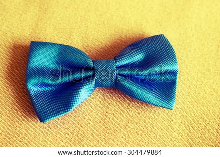 Blue bow in vintage tone - stock photo