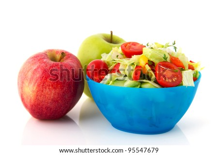 Blue bowl fresh mixed salad with tomatoes and apples for diet