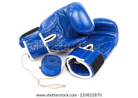 Blue boxing gloves and bandages isolated on a white background. - stock photo