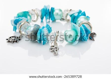 blue bracelet with pendants  - stock photo