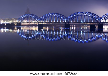 blue bridge in the night - stock photo