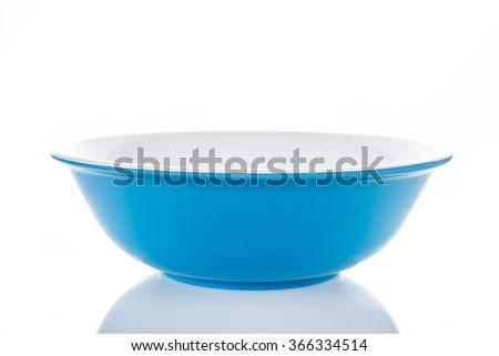 blue bright bowl on white. - stock photo