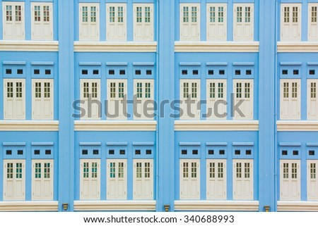 Blue building and white window in Singapore background.