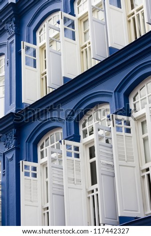 Blue building with white shutters and windows. China Town, Singapore