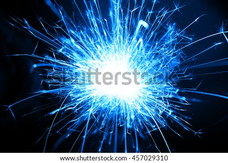 Blue burst of a sparkler in long exposure close up 1 - stock photo