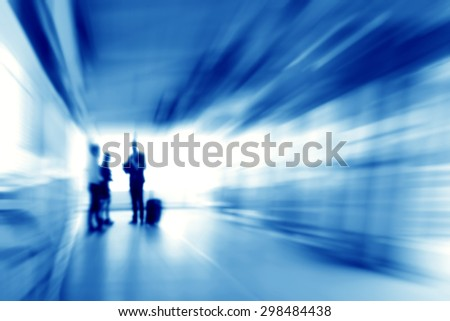 Blue business abstract background with people standing in the corridor, zoom effect