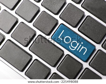 blue button with login word on computer keyboard background  - stock photo