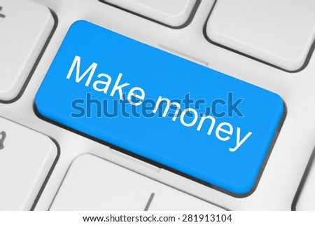 Blue button with make money words on the keyboard close-up - stock photo