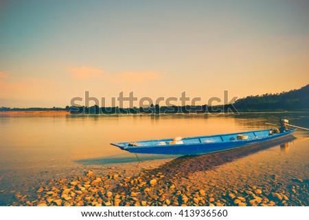Blue Canoe on the river Vintage tone,concept nostalgia - stock photo