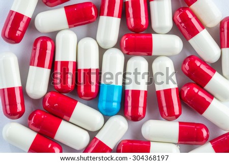 blue capsules and red capsules, illness medication cure pharmaceutical close up