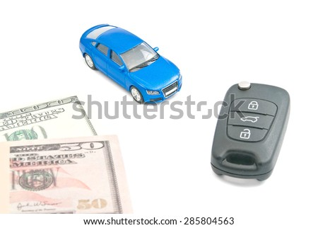 blue car, black car keys and dollar banknotes on white