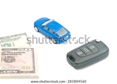 blue car, car keys and dollar banknotes on white