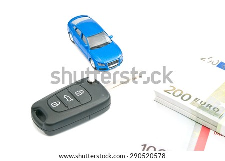 blue car, car keys and euro banknotes on white - stock photo