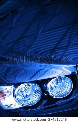 Blue Car Concept Photo. Blue Body Compact Car Hood and Headlight Closeup. - stock photo