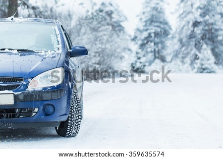 Blue car without a trade brand on winter road. - stock photo