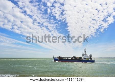 Blue cargo ship (tanker) is sailing near Vlissingen, the Netherlands - stock photo
