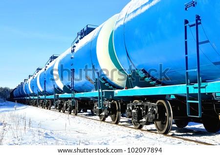 blue cargo train on the move in winter - stock photo