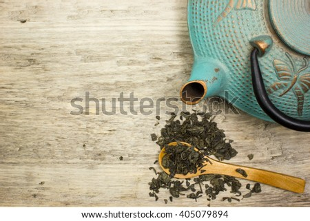 Blue cast iron kettle, dry green tea. Top view - stock photo
