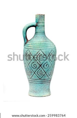 Blue ceramic jug vase with handle isolated on white background. - stock photo