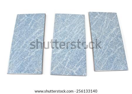 Blue ceramic tiles isolated on white - stock photo