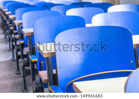 blue chair and table in classroom