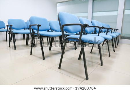 blue chairs in office meeting room