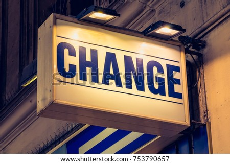 blue change signboard in a street of Paris, France