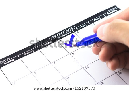 Blue check. Mark on the calendar at 1St January 2014 - stock photo