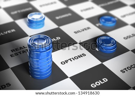 Blue checkers pieces over a financial board where it is written some investment words. Financial concept. - stock photo