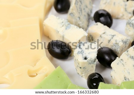 Blue cheese and olives. Close up. Whole background. - stock photo