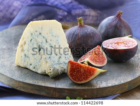 blue cheese and sweet fruit  figs on a wooden board - stock photo