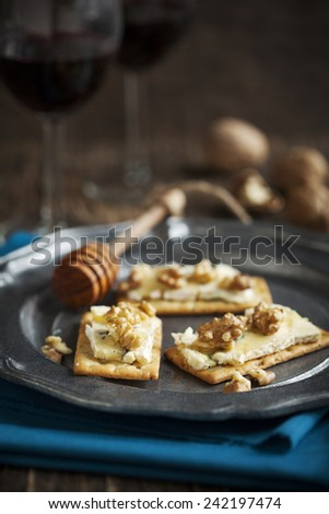Blue Cheese and Walnut Crackers with honey - stock photo