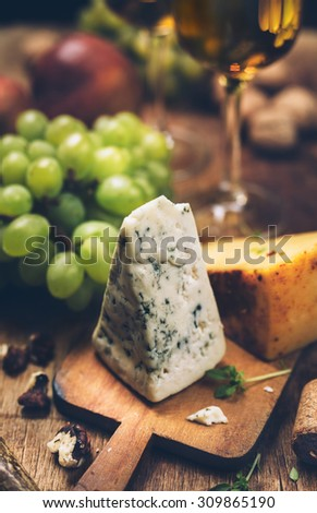 blue cheese and white wine, food background, toning image - stock photo